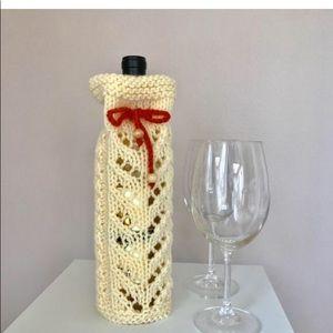 New Hand knit wine bottle cozy / sleeve .